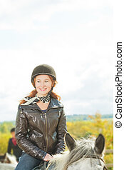 smiling red haired rider - young red haired jockette smiling...