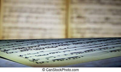 Sheet music, notes, light, shallow depth of field