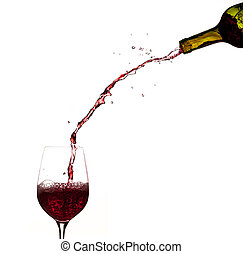 Wine pouring from bottle into glass - Red wine being poured...