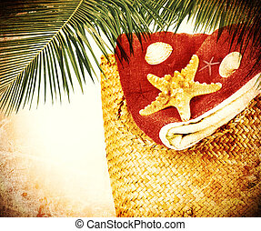 Beach items with palm branch, ?grunge conceptual image of...