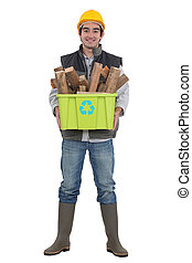Environmentally friendly tradesman taking out the recycling