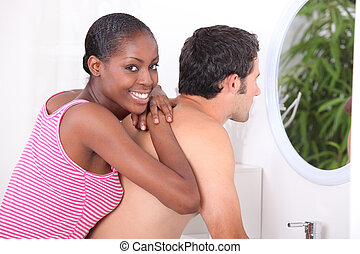 mixed couple in bathroom