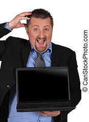 Amazed businessman holding a laptop computer with a screen left blank for your image