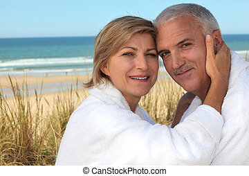 A cute middle age couple at the beach.