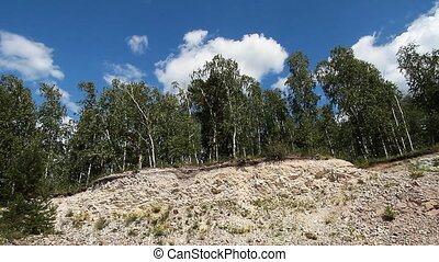 Trees in quarry 6 - Sky clouds and landscape trees in...