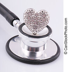 stethoscope - A black stethoscope with a ring as heart