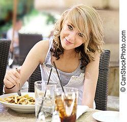 Teenage Girl at Outdoor Cafe - Cute blonde teenage girl...