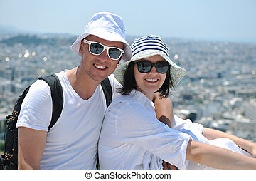 happy young couple tourists in greece - young couple...
