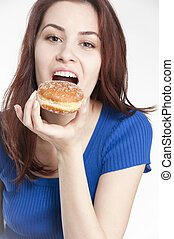 Young woman eating a donut