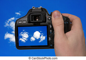 photography of the sky - hand holding photo camera and...