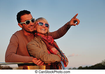 couple in love have romantic time on boat - happy young...