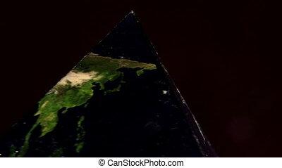 Earth in double pyramid, geometrical figures, closeup