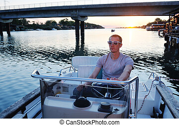 portrait of happy young man on boat - happy young man have...