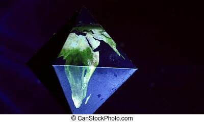 Earth in double pyramid, geometrical figures, blue space