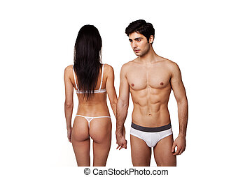 Fit Sexy Couple In Underwear standing side by side with the...