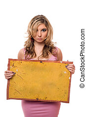 Young woman posing with yellow board