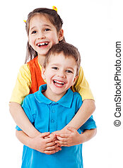 Two laughing little children standing together