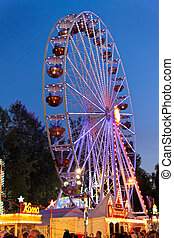 Ferris wheel at a carnival in the evening - ferris wheel...