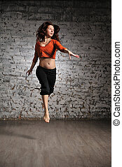 Girl in sportswear jumping