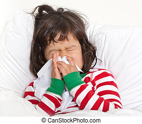 Child in Bed with Cold Sneezing - Little girl blowing nose,...