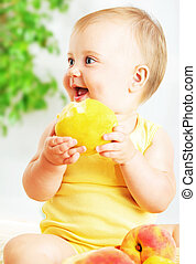 Little baby eating apple, closeup portrait, concept of...