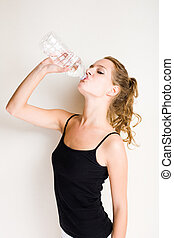 Hydrate! - Beautiful young blond fitnes girl drinking...