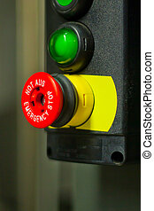 Red emergency stop button at the factory