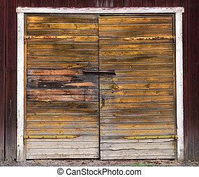 Wooden double door - Old weathered double wooden door on...