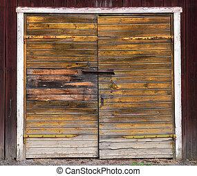 Wooden double door - Old weathered double wooden door on...
