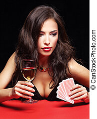 pretty woman gambling on red table - pretty young woman...