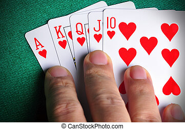 Winning Hand - Hand holding a Royal Flush poker card...