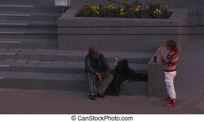 , RUSSIA -July, 08: Homeless people on the street at night, aerial view time lapse, July 08, 2011, Petrozavodsk, Russia. Homelessness is one of the main social problems all over the world.