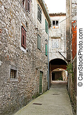Skradin street - Narrow street and old houses in Skradin...