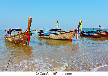 A native boats Longtail stand on an anchor - Gentle warm...