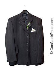 Suit jacket hanging on a hanger with a boutonniere in place...