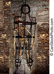 Human skeleton trapped in a cage - A skeleton chained in the...