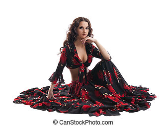 young woman sit in gypsy black and red costume - young cute...