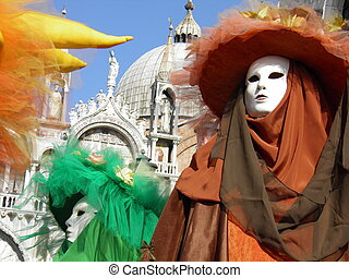 Colorful carnival masks in Venice. On the background the Saint Mark's Basilica