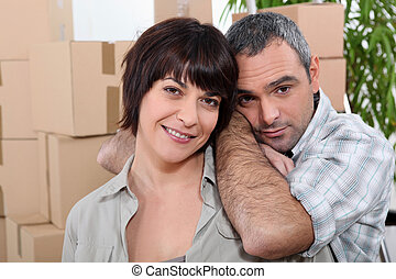 man and woman moving into a new apartment