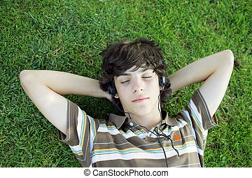 Teen lying on the grass
