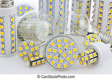 various bulbs with 3-chip SMD LEDs next to tungsten bulb