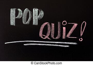 Pop quiz written in chalk on a blackboard