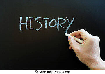 Writing the word history on a blackboard - Writing the word...