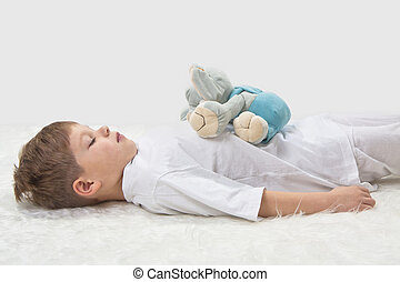 Childrens yoga Yoga before a sleeping The kid with a...