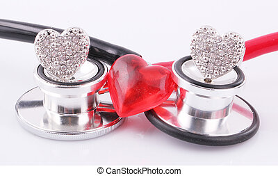 stethoscopes - Black and red stethoscopes with rings as...