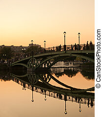 Reflection of the bridge at sunset