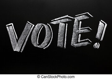 Vote word written on a blackboard - Vote word written in...