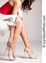 high heels - woman legs in silver high heels shoes, studio...