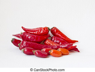 Red cayenne pepper - several cayennes lying on white...