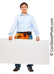 Smiling construction worker holding blank billboard